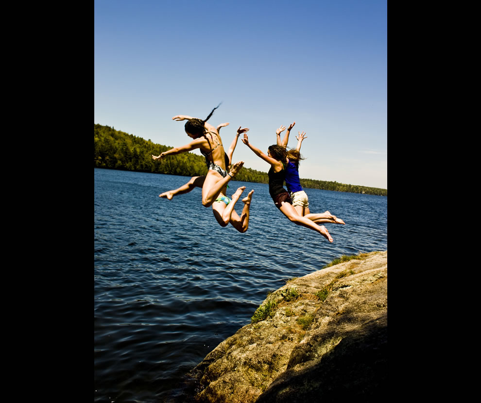 Four jump into the frigid water of Echo Lake, Acadia National Park, Maine
