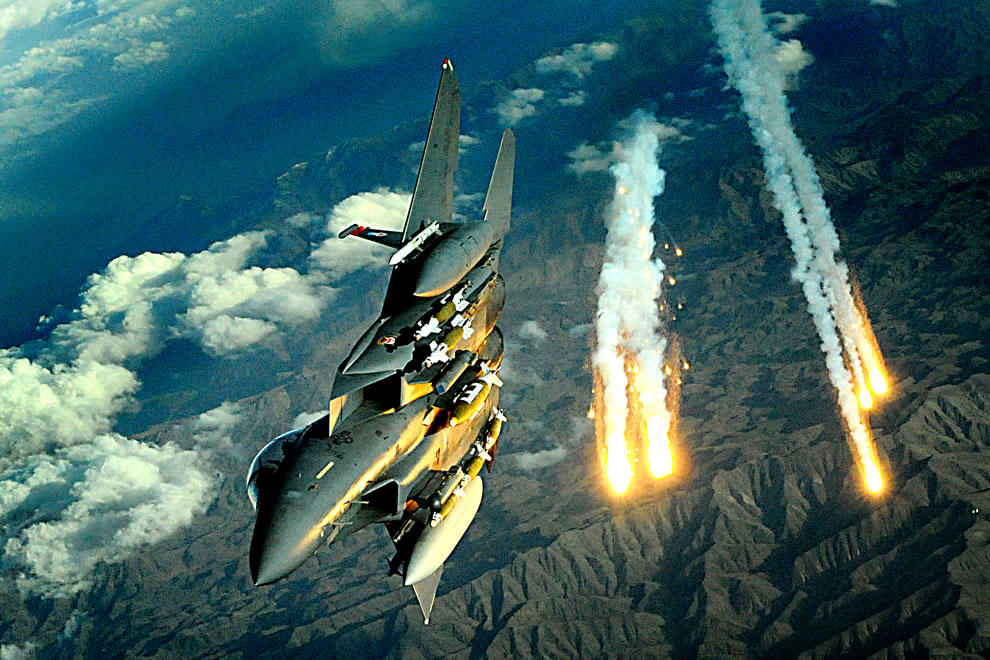 A U.S. Air Force F-15E Strike Eagle aircraft from the 391st Expeditionary Fighter Squadron deploys flares during a flight over Afghanistan