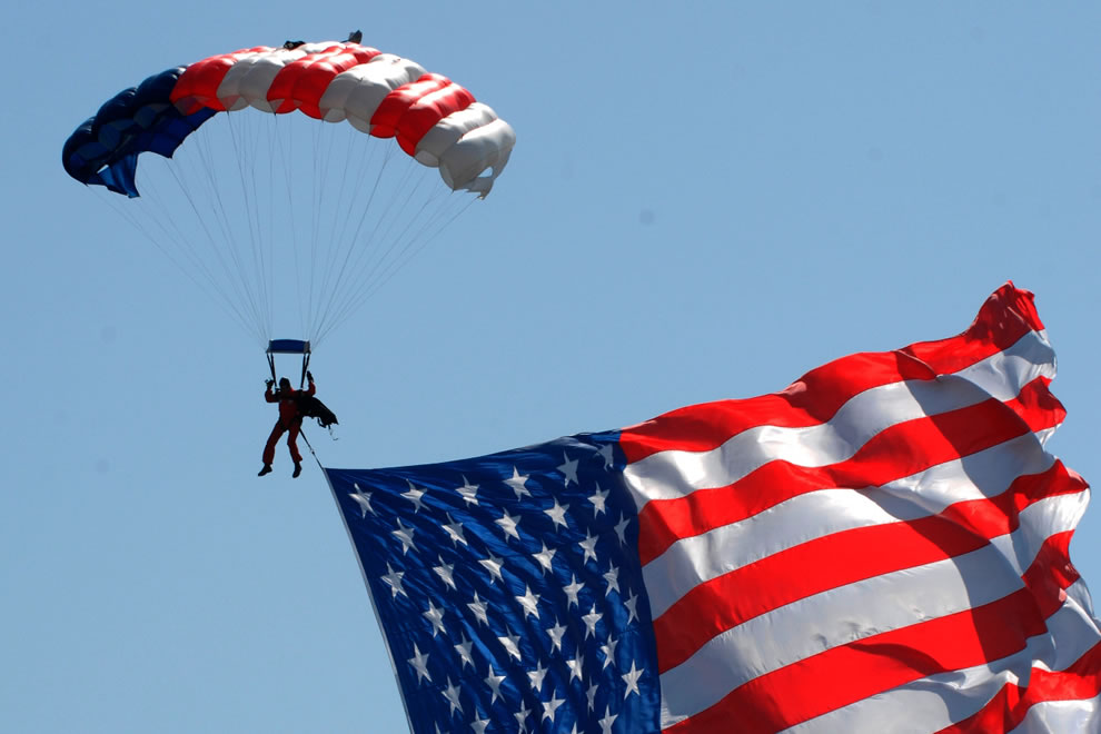 Former U.S. Army Special Forces soldier Paul McGowan drops into the opening ceremonies at the Joint Service Open House on Andrews Air Force Base, Md