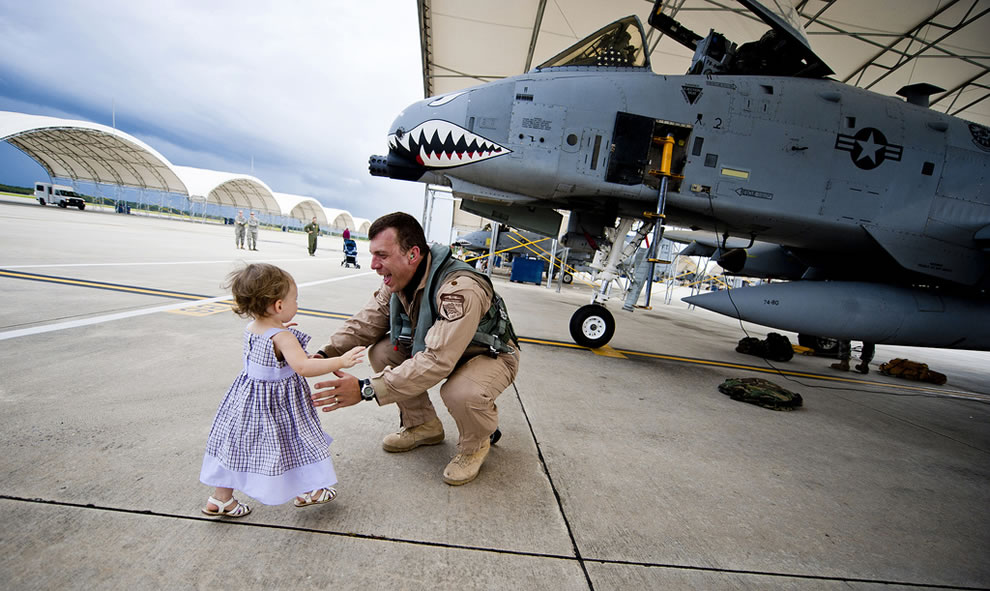 U.S. Air Force Maj. Craig Morash, 74th Fighter Squadron A-10 close air support aircraft pilot, is greeted by his daughter, Adeline, after returning home from a deployment