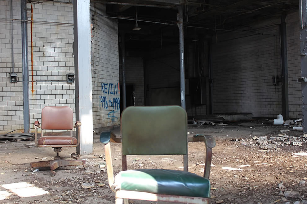 Inside derelict, demolished, Emge Food Processing plant 2 lonely chairs