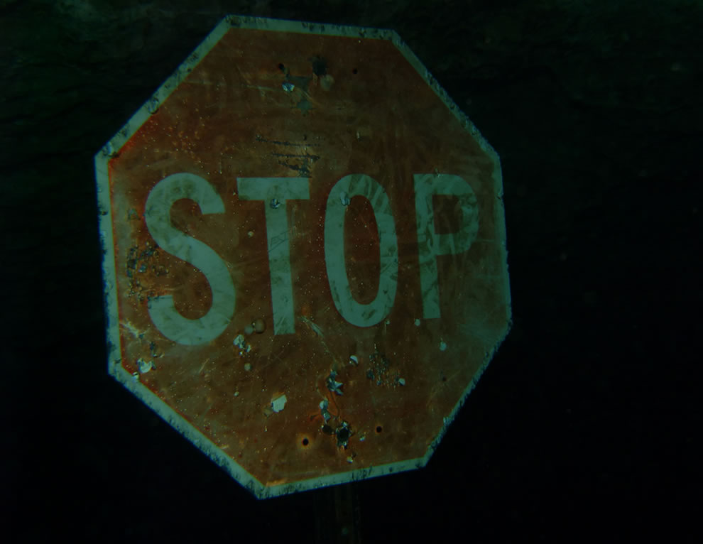 Stop sign, not DOT approved, underwater warning at Vortex Spring