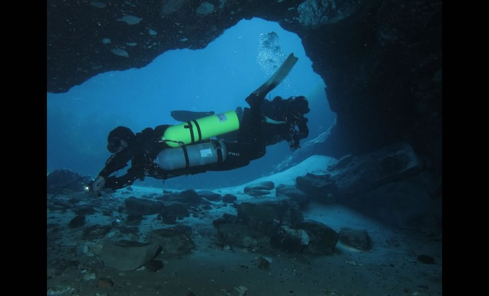 Two scuba divers inside the cave at Vortex Spring
