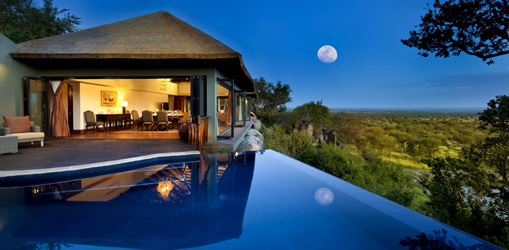 Infinity pool and full moon at Bilila Lodge Kempinski in Tanzania's Serengeti National Park