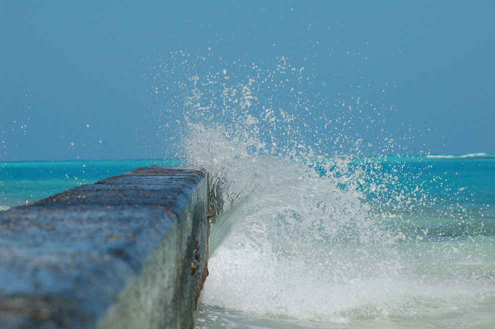 waves crashing into the little sea wall in the dry tortugas