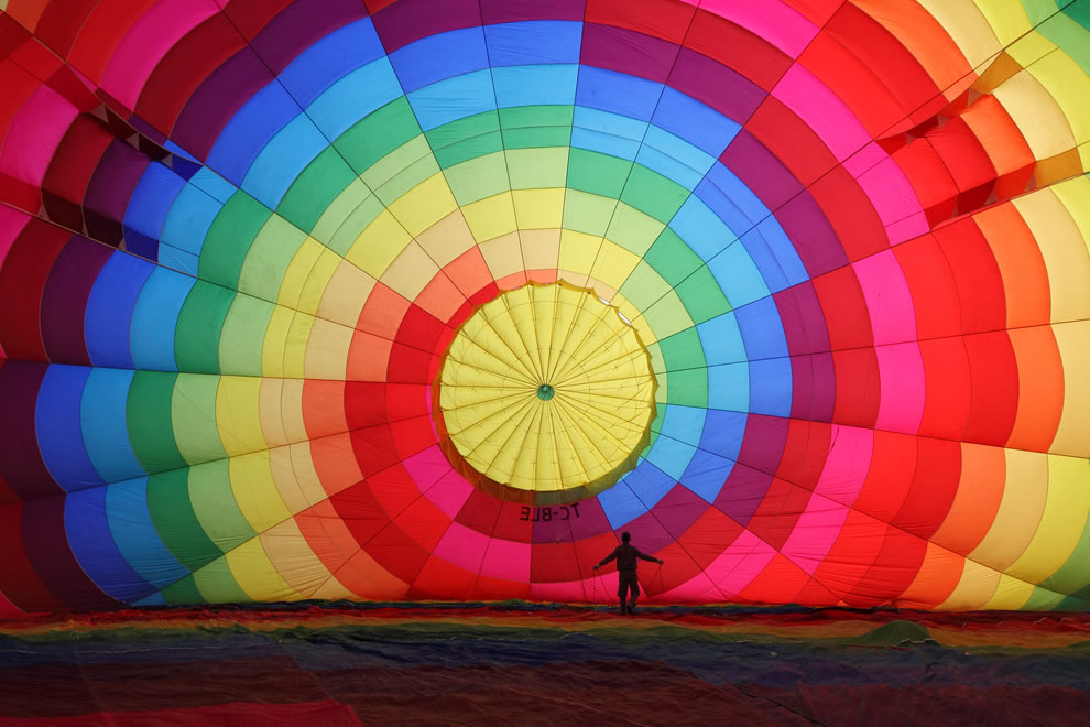 A hot air balloon being inflated before air trip over Cappadocia, central Turkey, as seen from inside