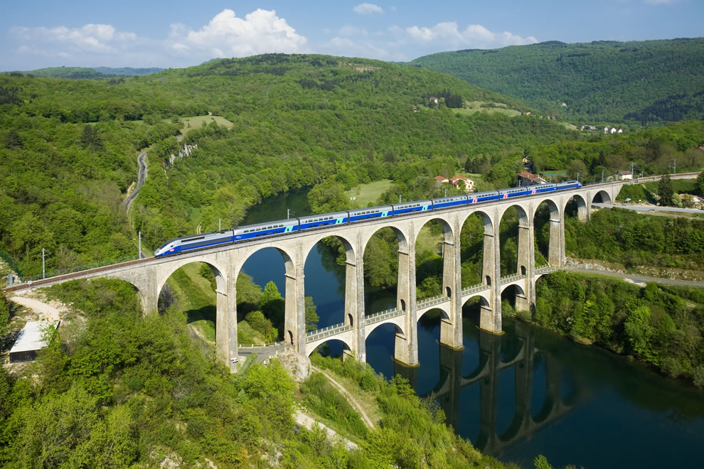 World Photography Day celebrates Wikimedia Commons Pictures of the Year 2011 Winners  -- # 5 A SNCF TGV Duplex trainset is crossing the Cize - Bolozon viaduct over the Ain river