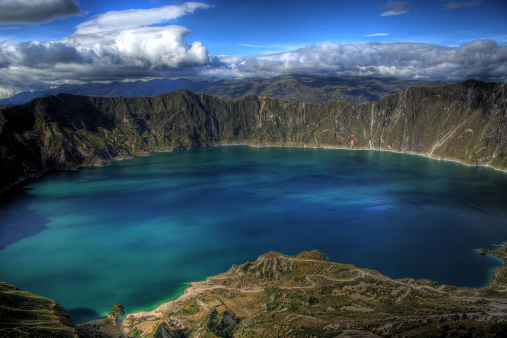 Lake Quilotoa is a water-filled caldera and the westernmost volcano in the Ecuadorian Andes