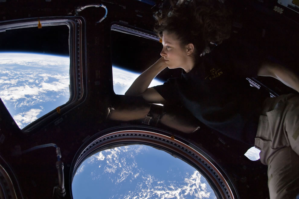 Wolrd Photography Day -- Self portrait of Tracy Caldwell Dyson in the Cupola module of the International Space Station observing the Earth below during Expedition 24