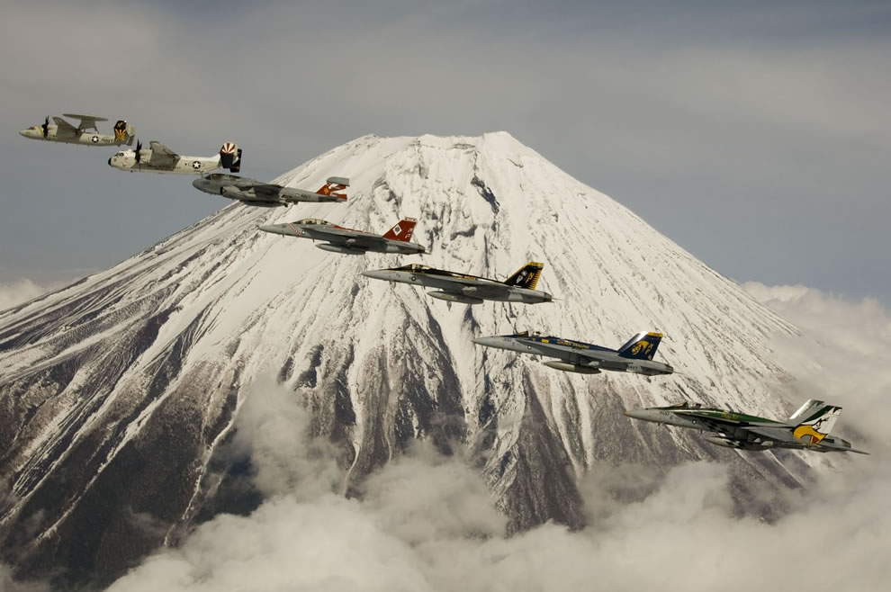 7 Navy jets flying over snow-capped Mount Fuji