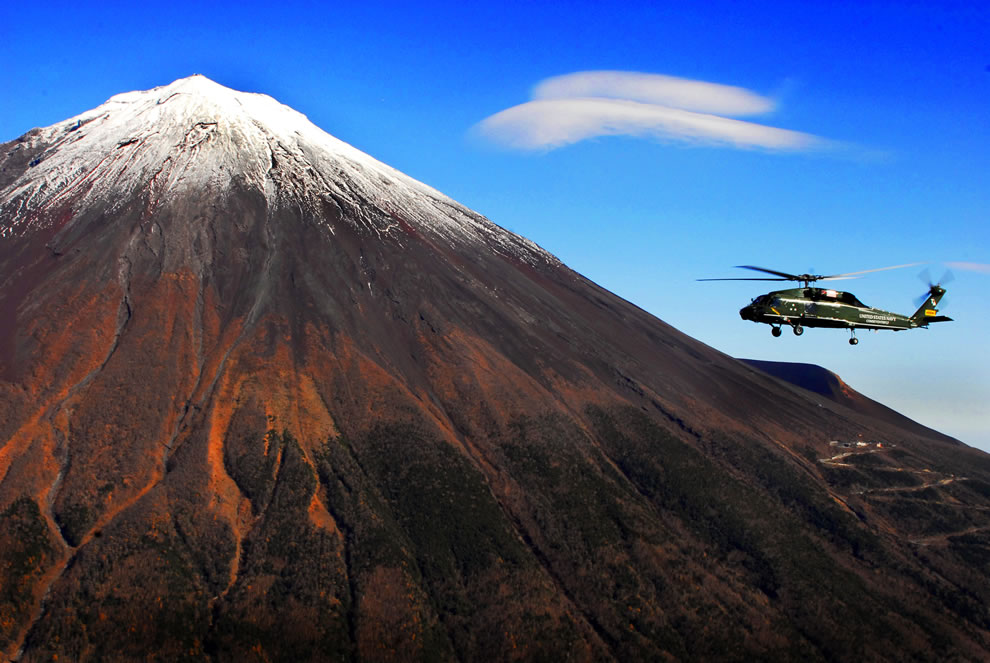Aerial photo, An SH-60F helicopter from the Warlords of Helicopter Antisubmarine Squadron Light 51 Det. 11, flies in front of Japan's Mt. Fuji