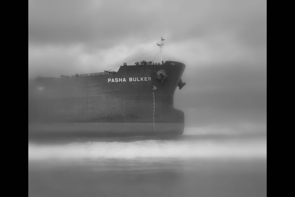 Fogs makes an eerie setting for the shipwrecked Pasha Bulker at Nobbys Beach, Newcastle