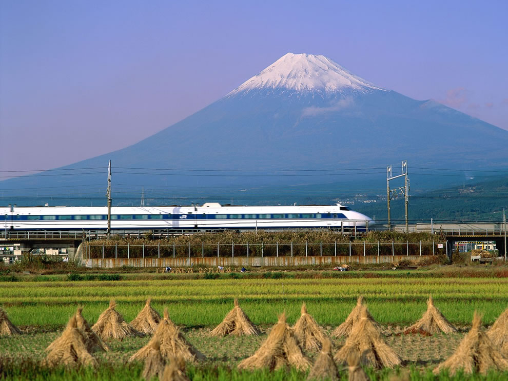 Harvesting fields as Bullet Train screams past Mount Fuji