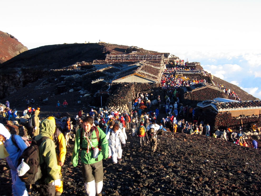 Hikers crowded at the summit of Mount Fuji