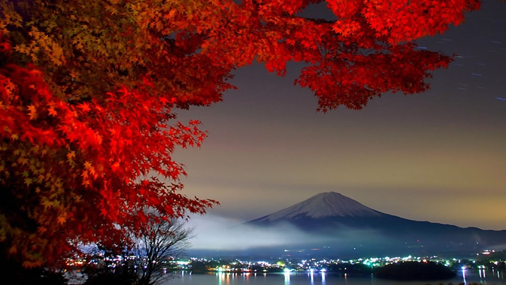 Night view of Mt. Fuji with red autumn leaves from Kanagawa