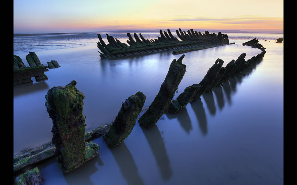 Ribs of a relic, Norwegian SS Noren at sunset in England