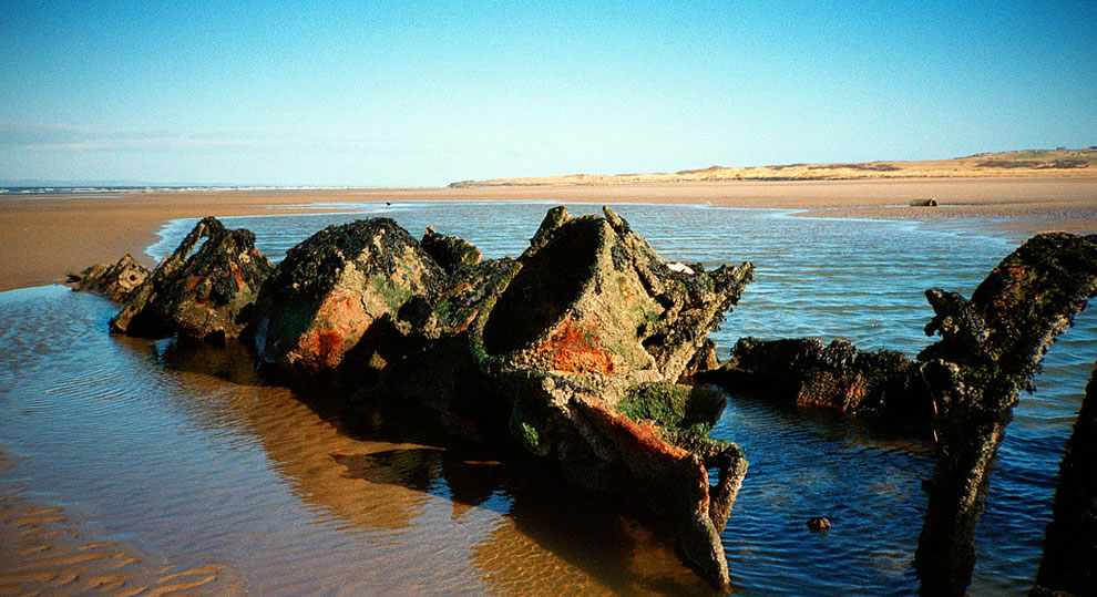 Rusted relic, wreck of a midget submarine at Aberlady Bay in Scotland
