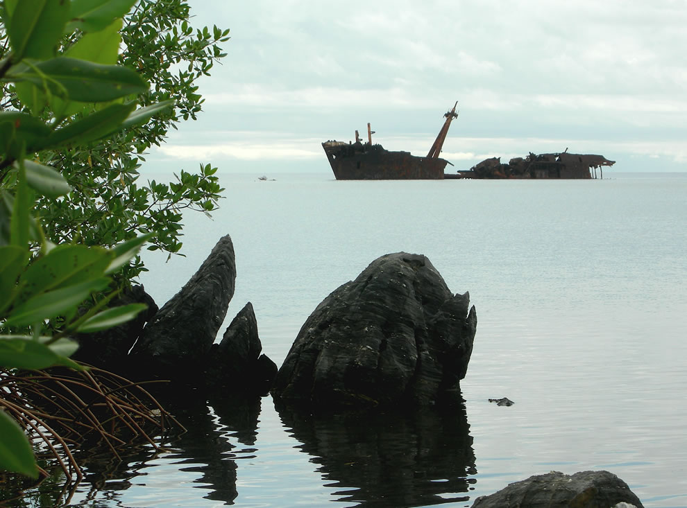 Shipwreck at Roatán, Honduras. It was carrying building materials when it ran aground. Locals salvaged most of the cargo and the ship has rested there ever since