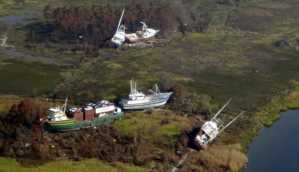 Shipwrecked by Hurricane Katrina, Bayou La Batra 2005 boats ashore