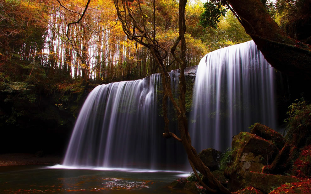 Autumn colors and a waterfall, fall season in the woods