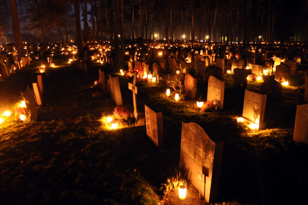 Graves lit by candles in Sweden on All Souls Day