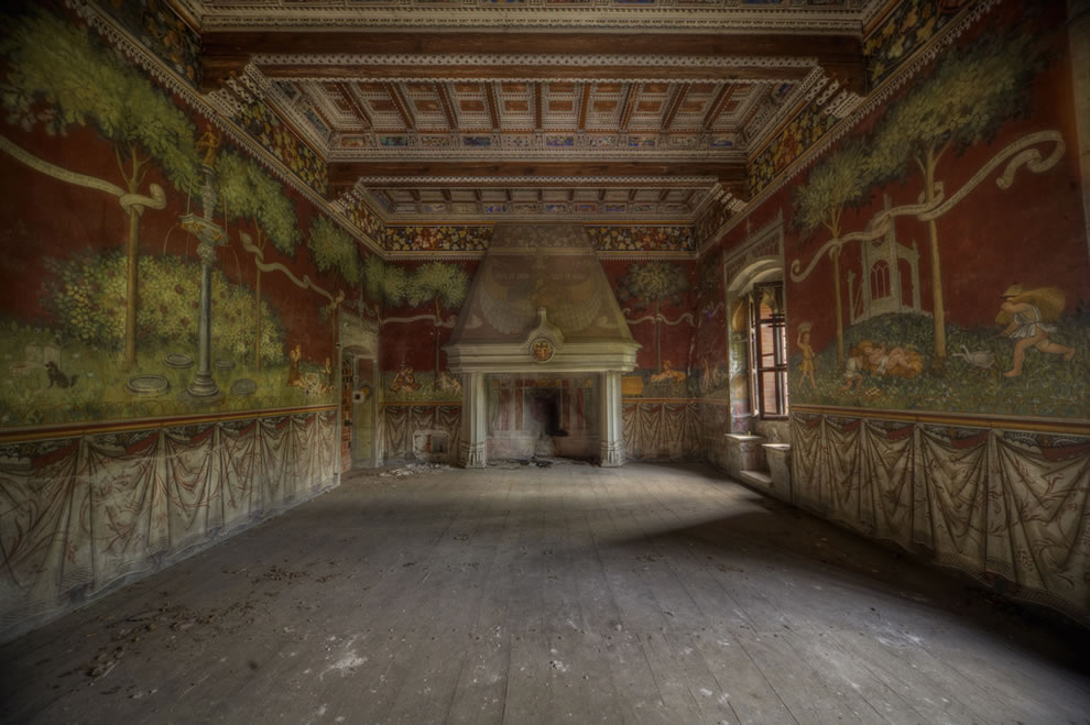 This abandoned mansion had a draw bridge and beautiful painted walls in most of the rooms