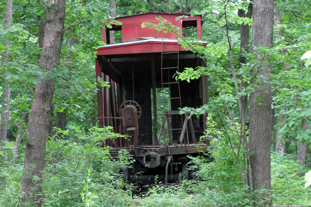 Creepy caboose in the middle of the woods