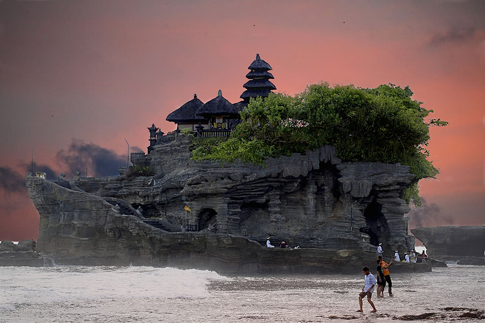 A Bali sunset and Tanah Lot Temple, one of seven sea temples