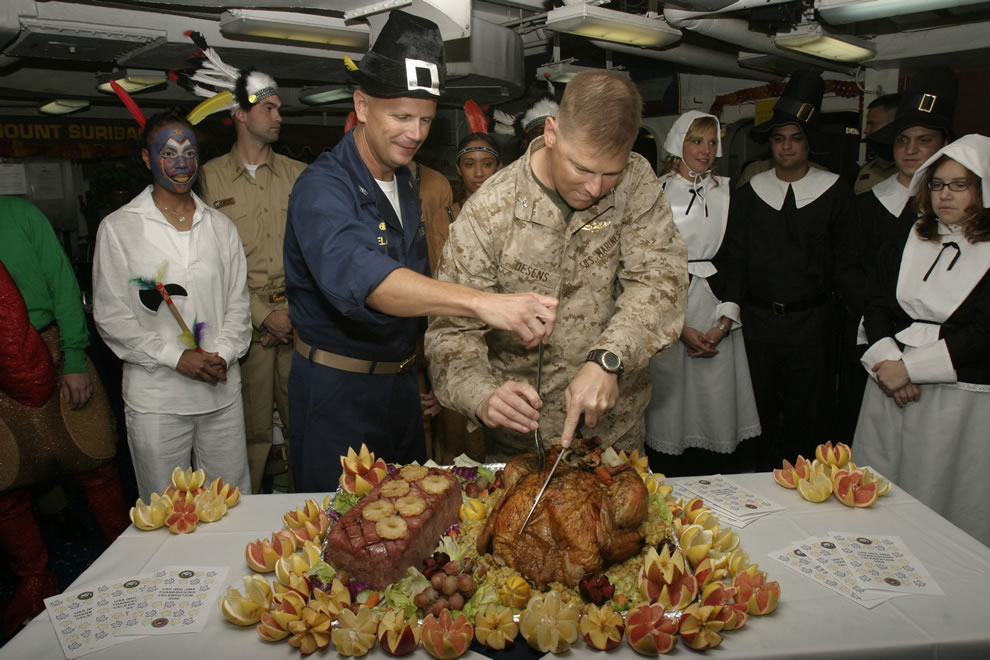 Captain Robert Irelan and Colonel Mark J. Desens carve the Thanksgiving turkey aboard USS Iwo Jima