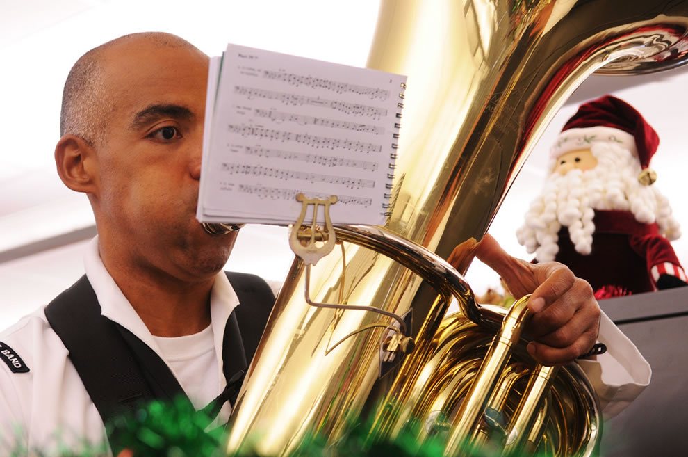Musician 3rd Class Roberto Wharton, assigned to U.S. Pacific Fleet Band, plays holiday tunes