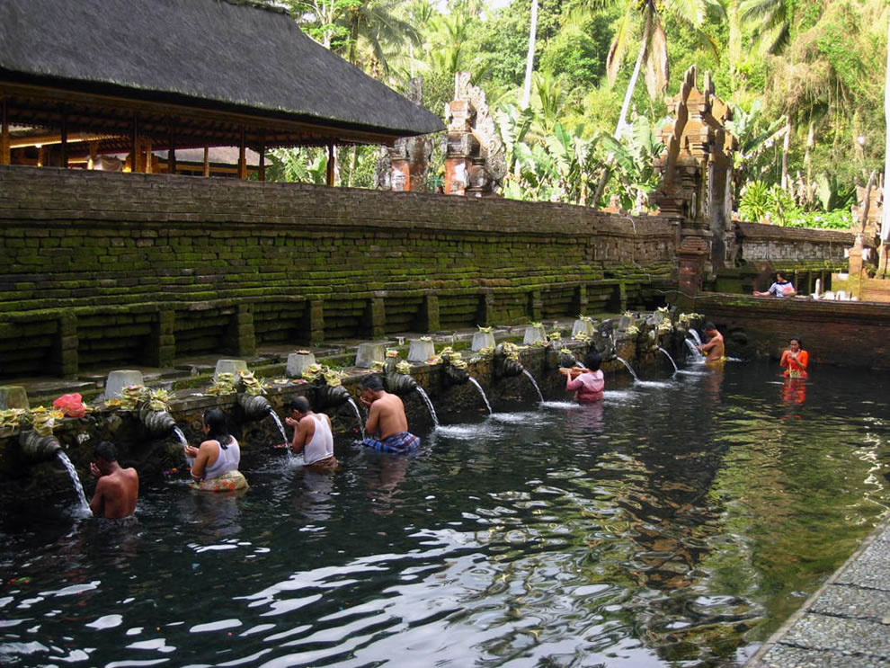 Pura Tirta Empul and people washing in the sacred water thought to have healing powers