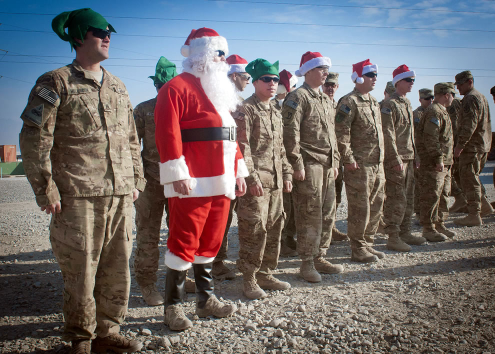 U.S. Air Force Senior Airman Michael Lausier, second from left, portrays Santa Claus while in formation with a group of fellow soldiers