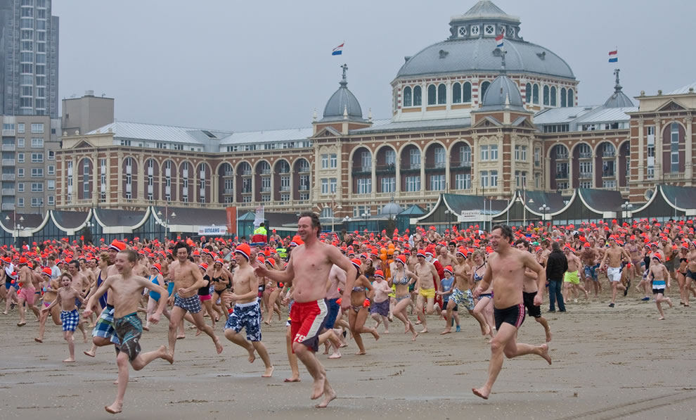 10,000 people run toward the freezing water for Nieuwjaarsduik, a New Year's Dive, Scheveningen, Netherlands