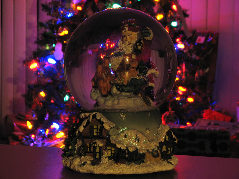 Holiday Christmas lights and Santa snow globe