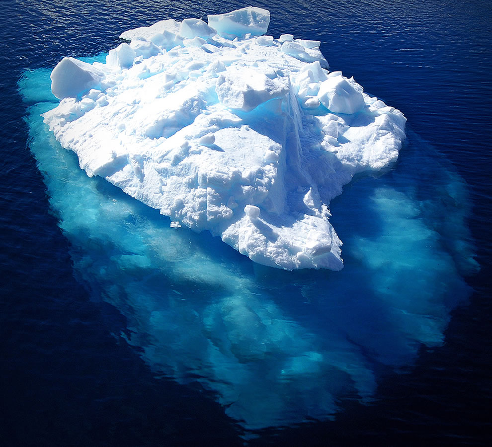 Antartica iceberg below and above