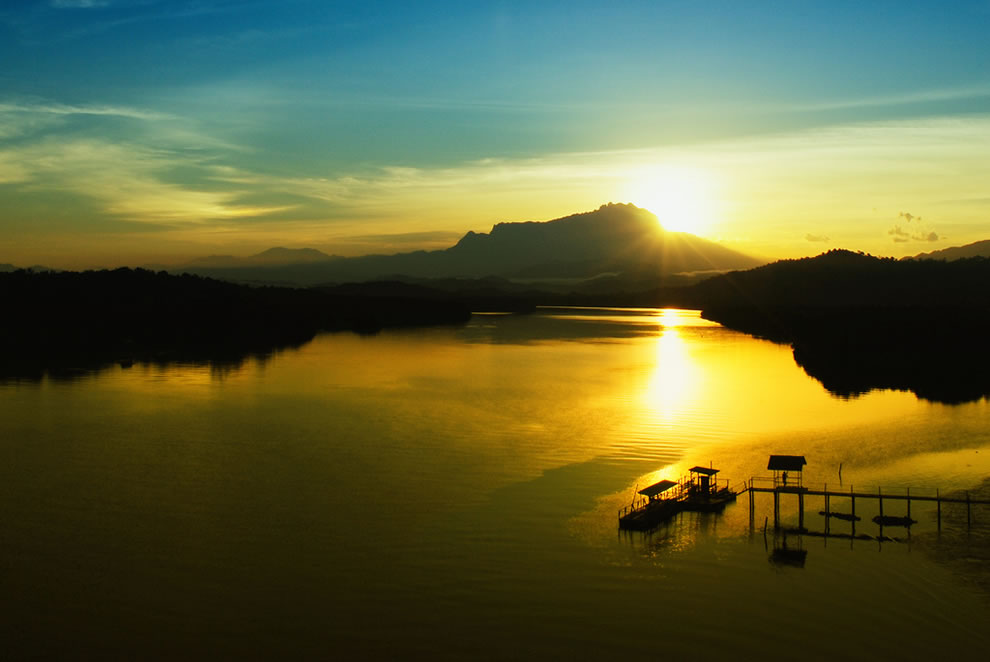Sunrise over Borneo Malaysia is the 3rd highest point on an island with Mount Kinabalu