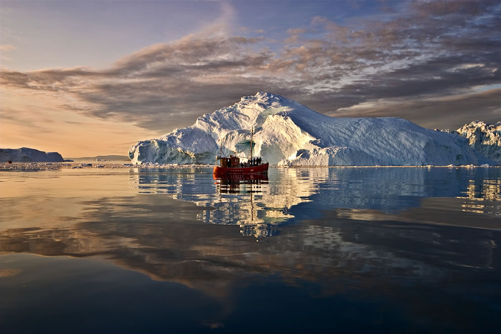 Calm sea at sunset, Greenland icebergs and boat