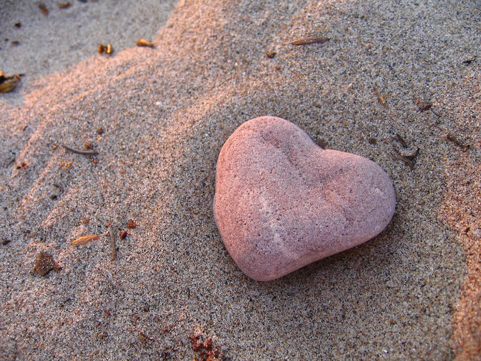 Heart rock on the sandy beach of Centre Island, Toronto Islands