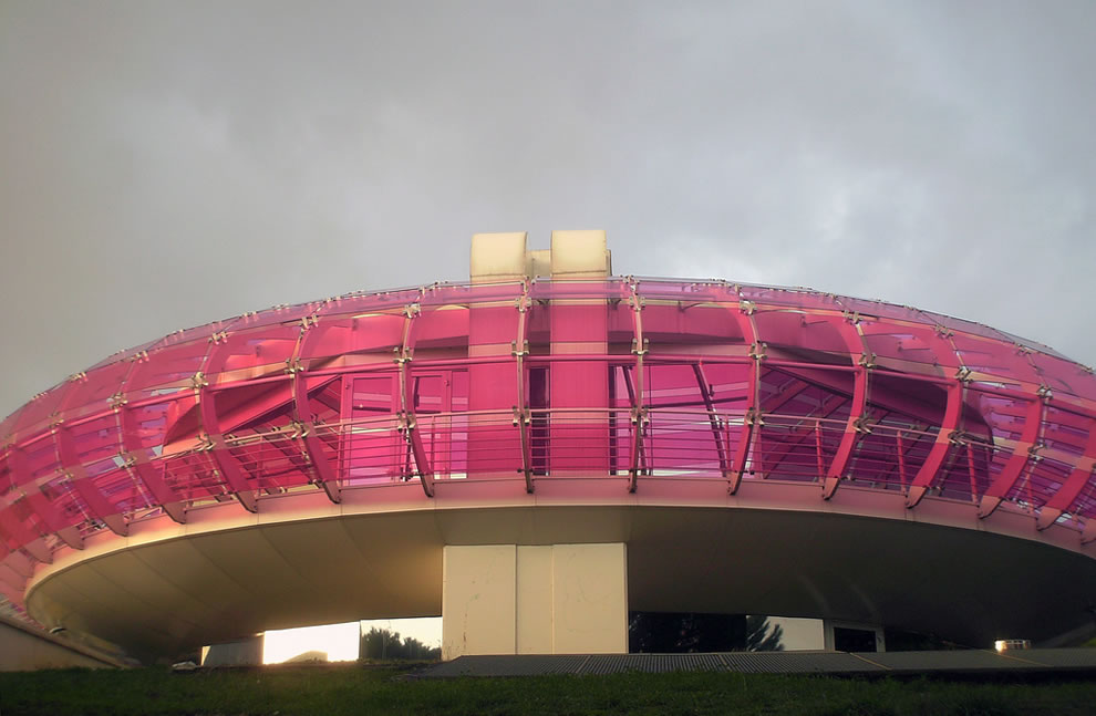 Biblioteca Sandro Penna in Perugia, Italy, think pink UFO then picture that flying saucer as a library