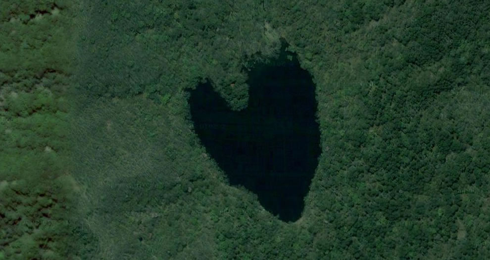 Flipped aerial image of a lake shaped like a heart on the island of Hokaido, Japan