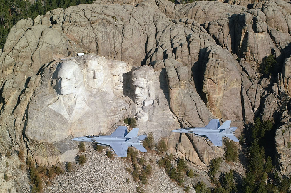 Two Hornets flying by Mount Rushmore