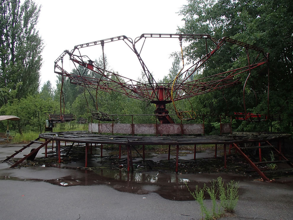 Day trip to Chernobyl, June 2012, derelict swings in Pripyat amusement park 26 years after abandonment due to disaster