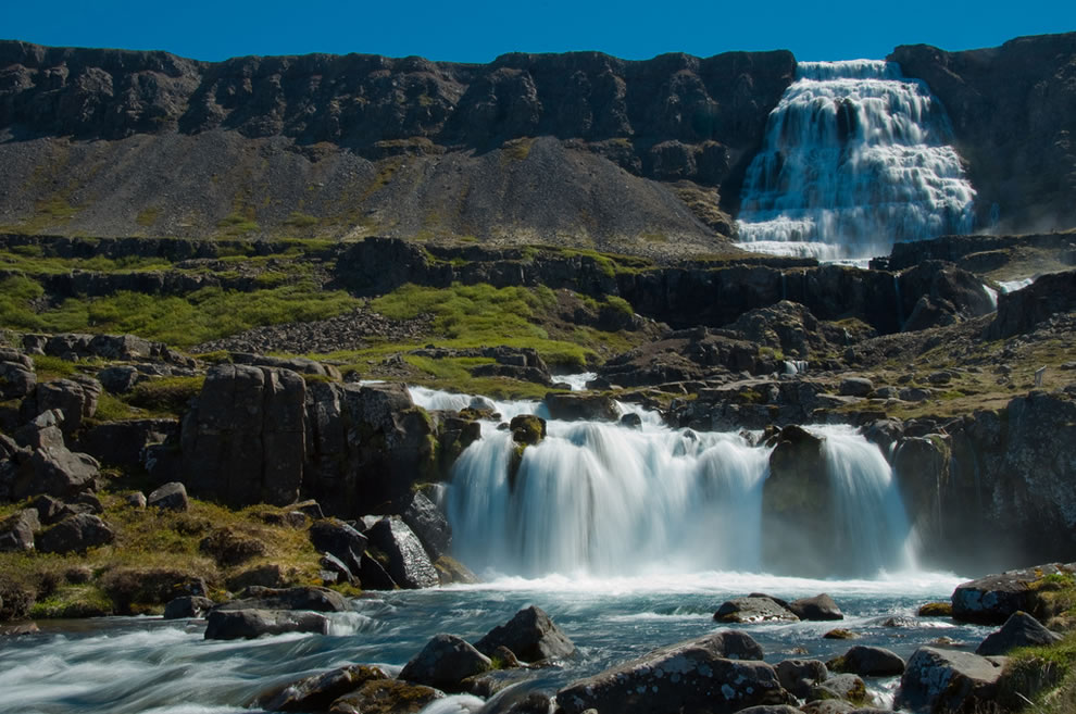 330 ft, 100m, Dynjandi (also known as Fjallfoss) is a set of waterfalls located in Westfjords OF Iceland