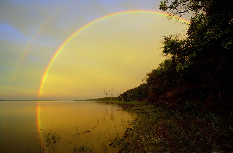 Double rainbow at sunset over Clinton Lake, Kansas