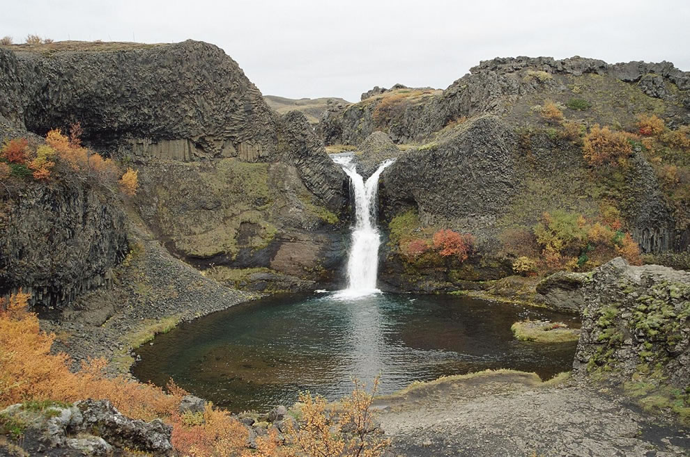 Part the small canyon of Gjáin waterfall in the south of Iceland. A multitude of small waterfalls characterize the landscape
