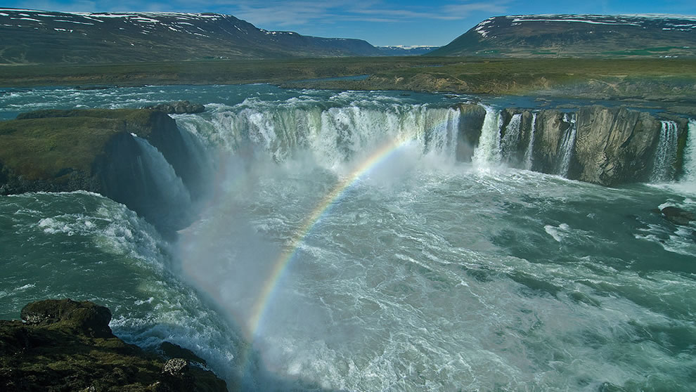 Rainbow over Goðafoss waterfall in northern Iceland