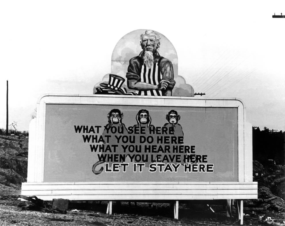 Uncle Sam and see, hear, speak monkeys for secrecy on billboard in Oak Ridge in December 1943