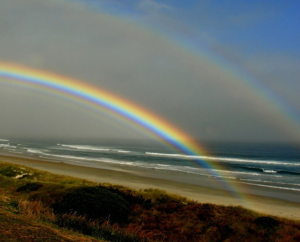 Double rainbow, New Zealand beach