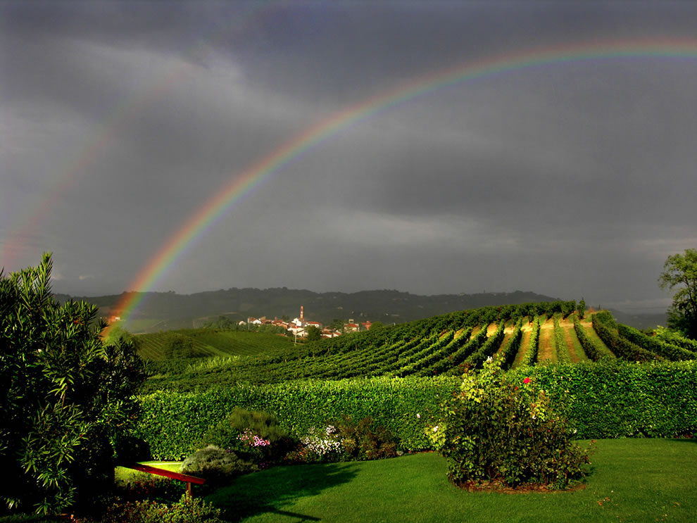 Double rainbow over Italy vineyards