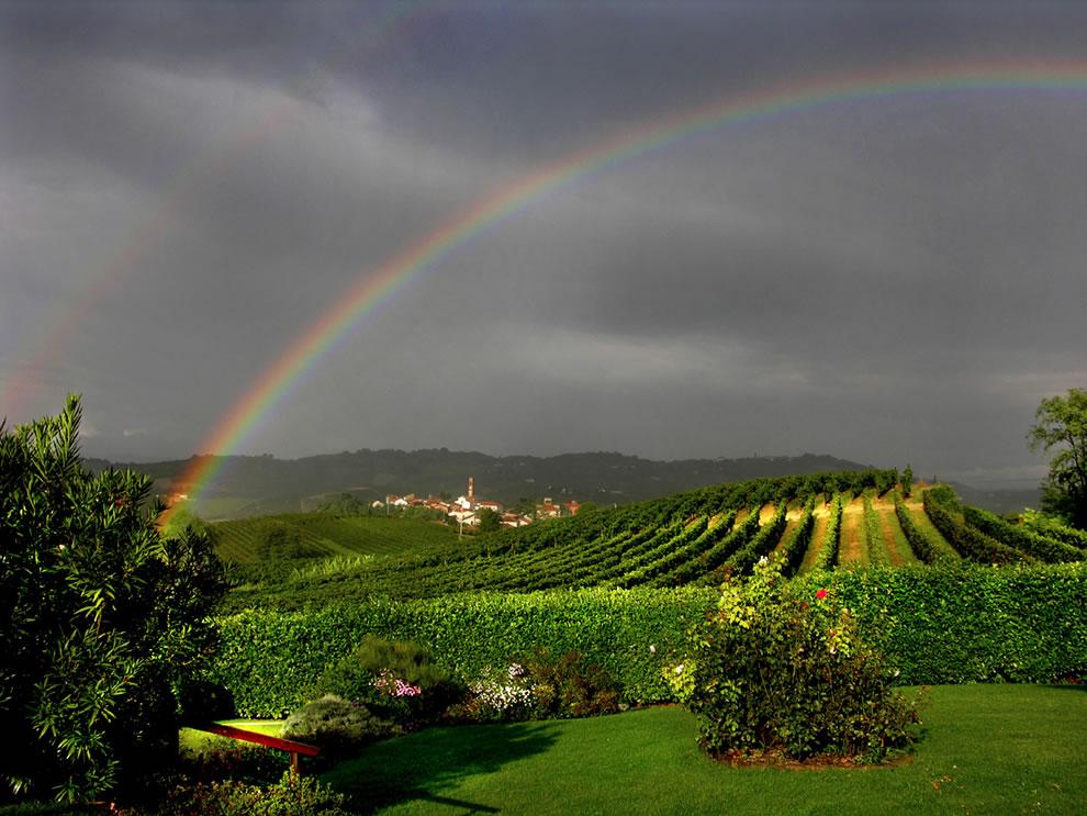 Double rainbow over Italy vineyards